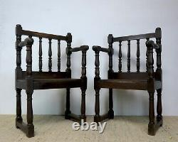 Pair of 19th Century French Dark Oak Correction Hall Chairs