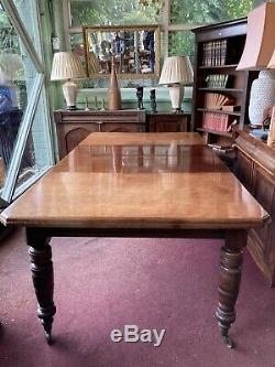 Victorian French Polished Extending Dining Table On Turned Legs And Castors