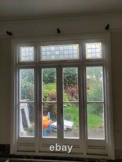 Wooden painted external french / garden doors with stained glass fanlight